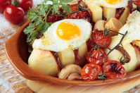 Potatoes, baked with bacon, mushrooms and tomatoes