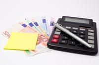 Money,Calculator and Pen