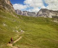 Girl in Mountain Bike on Italian Dolomites