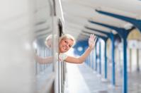 Young women waving  from train