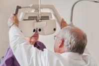 Man Looking Through Optical Refractor