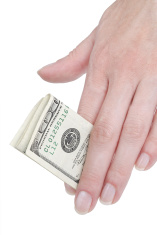 Hand with banknote