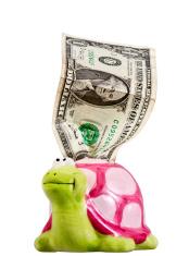 One crumpled dollar & piggy bank