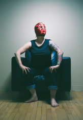masked woman with tattoos