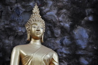 Stupa in front of rock