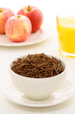 breakfast  with fresh apples, orange juice and wheat bran cereal