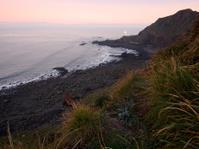 Hartland Lighthouse and shipwreck at Sunrise, Devon UK