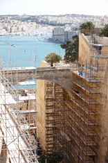 Tall scaffolding on ancient Maltese building