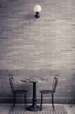 Two chairs and a table with nobody there