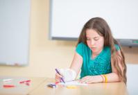 girl writing and drawing