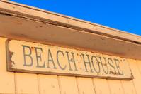 wooden beach house sign