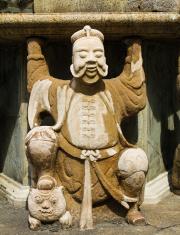 Statue of Man at Wat Pho in Bangkok, Thailand.