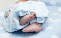 Baby's feet and toes on soft blanket