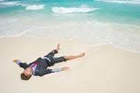 Castaway Businessman Lies Stranded on Tropical Beach