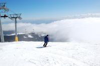 Skier rides on a slope in Strbske Pleso ski resort