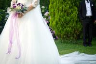 Bouquet in hands of the Bride
