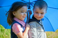 Two friends under an umbrella