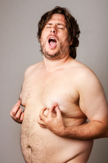 Man pleasuring his own nipples