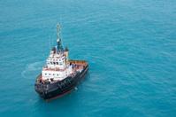 Tugboat In Tropical Blue Ocean Water