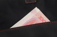 Exposed corner of the money in wallet