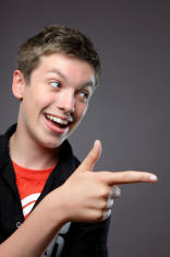Teenage Boy pointing to the Left