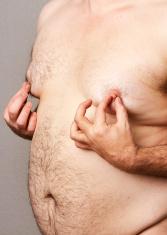 Fat man at his nipples