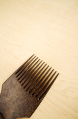 Afro Comb On Wooden Background
