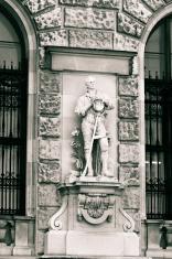 Statue in Neue Burg facade. Vienna, Austria