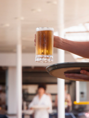 Server Carrying Mug of Beer