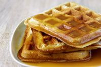 Stack of homemade waffles  with sweet sauce
