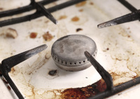 Burner of old dirty gas cooker