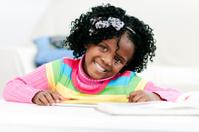 African little girl doing homework