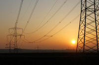 electrical tower pylon and sun