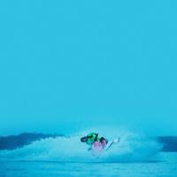 man ridding a jet ski