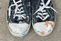 Splattered gym shoe