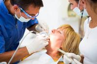 Senior woman at the dentist... team working