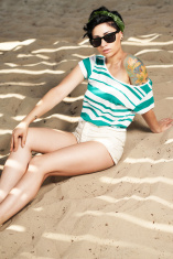 adorable girl with tattoo wearing sunglasses