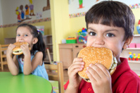 Boy And Girl With Hamburgers