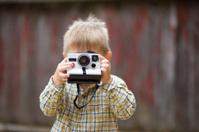Portrait of child with Polaroid