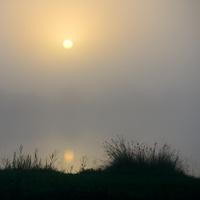 Sunrise over Foggy Lake