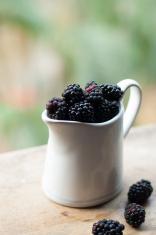 Blackberries in a white jar