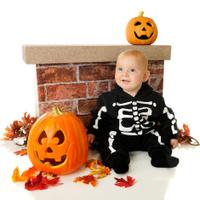 Tiny Skeleton Among Pumpkins