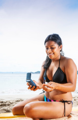 Checking blood glucose levels at the beach