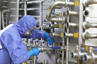 Technician fixing valves in plant
