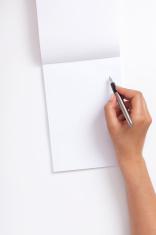 woman writing blank notebook