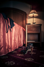 High heels and lingerie in hotel bedroom