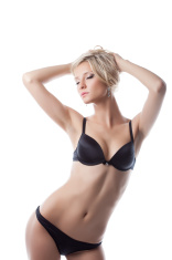 sexy young blond woman posing in black lingerie