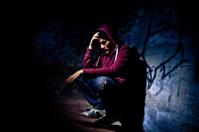 Man Desperate and Alone in Dark Alley