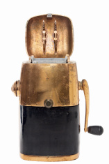 antique black and gold colored ice crusher with open lid