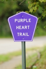 Purple heart trail sign